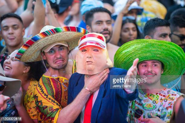 Two men dressed in Mexican attire and a Man dressed as US President Donald Trump pose for a photo during the 2020 Sydney Sevens at Bankwest Stadium...