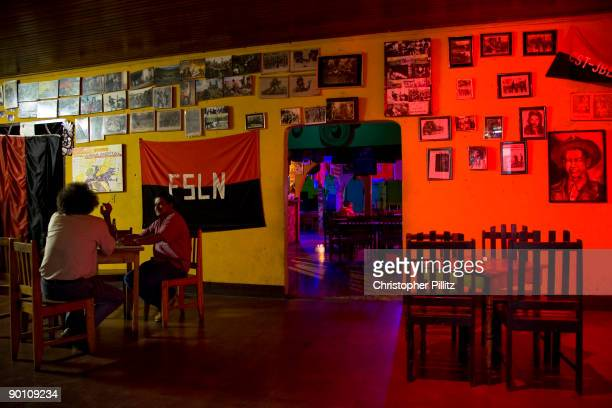 Two men drink in Bar El Rincon Legal in Esteli This is a sort of a shrine or museum to the civil war There are photographs arms flags and wide...