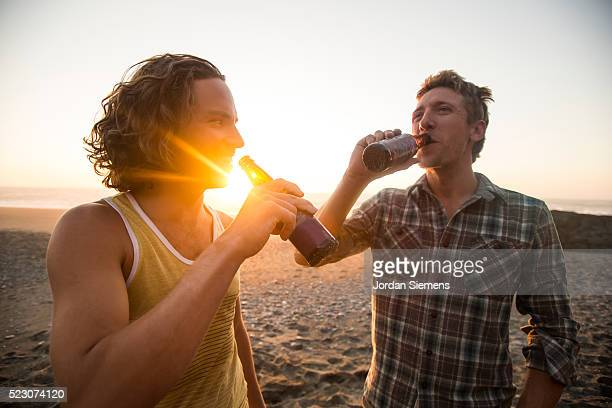 two men drinking beer at sunset, eureka, california, usa - mid adult men stock-fotos und bilder