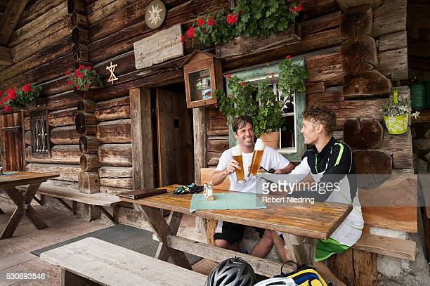 Two men drinking beer together, Hornbacher Alm, Chiemgau, Germany