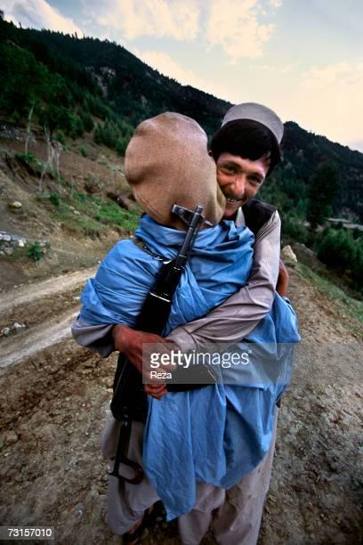 Two men embrace in a Shiite village on July 2004 in Kalachi Pakistan
