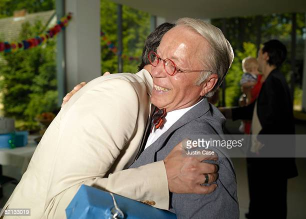 Two men embracing at family