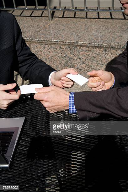 Two men exchanging business cards