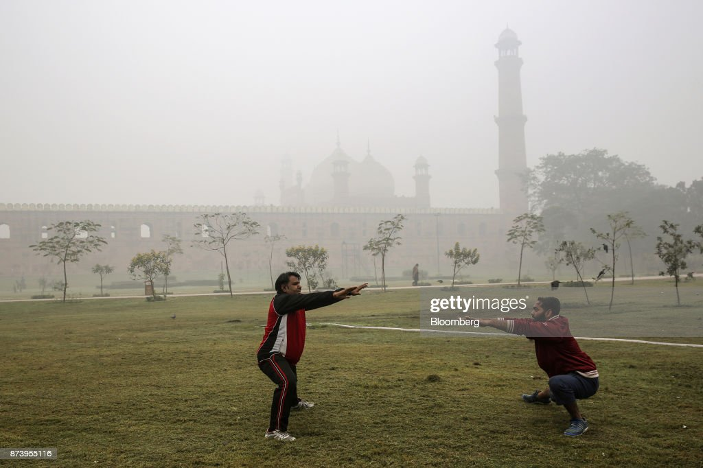 Two men exercise in Iqbal Park shrouded in smog in Lahore Pakistan on Tuesday Nov 14 2017 The fates of 15 billion people in both India and Pakistan...