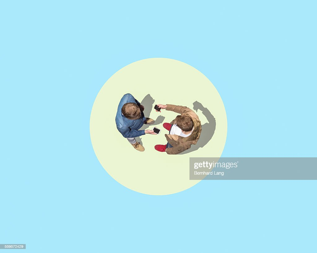 Two men facing with mobile phones, Aerial Views : Stock Photo