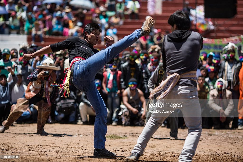 Two men fight during Takanakuy celebrations in the region of Chumbivilcas, Cuzco in the Andes of southern Peru on December 25, 2014. The Takanakuy is a traditional celebration held every December 25. The celebration can last many days. The word 'Takanakuy' means 'to strike with the fist' and fighters are heating with dances and songs called Wayliyas. Men and women who have had problems with other people during the year are fixing their conflicts at the end of the year with one or several fights. Usually, conflicts are raised by issues related to land or harvesting, stealing animals or insulting the name of the father. Some collisions are caused by love or friendship issues.