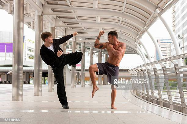 Two men fighting in urban environment