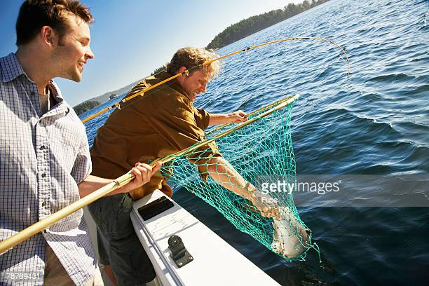 Two Men Fishing in Motorboat