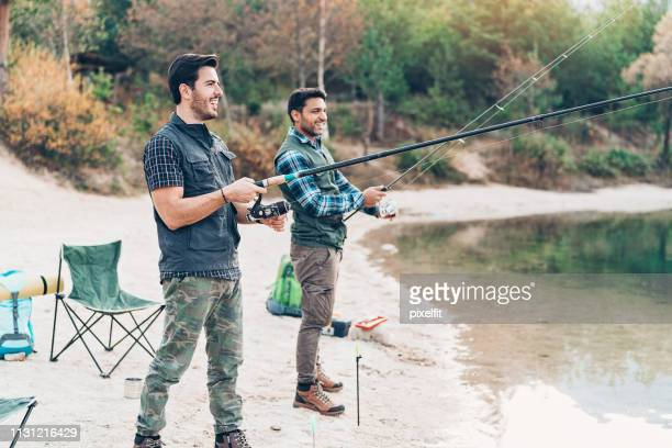 two men fishing together - fishing tackle stock pictures, royalty-free photos & images