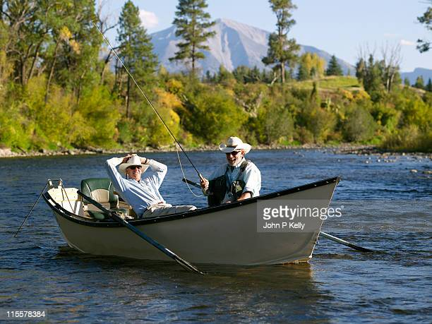 Two men float fishing on mountain river