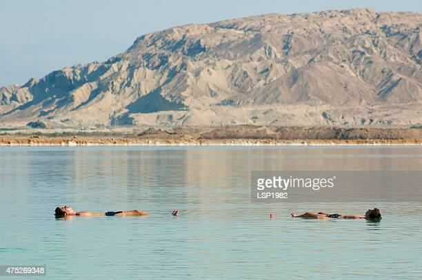 Two men Floating in the Dead Sea