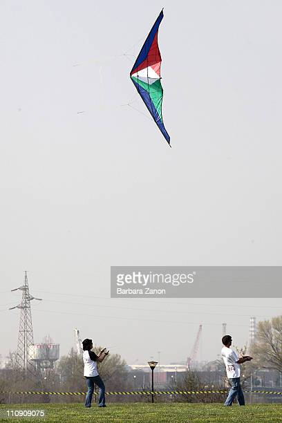 Two men fly kite during the first 'Festival of Spring and North Winds' kite festival at Parco San Giuliano on March 26 2011 in Mestre Italy Many...
