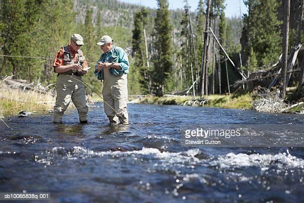 Two men flyfishing in river