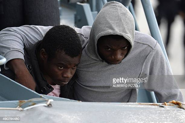 Two men from a group of 140 migrants and refugees mainly from Nigeria Ghana Senegal and Sierra Leone who were transported by the German navy frigate...