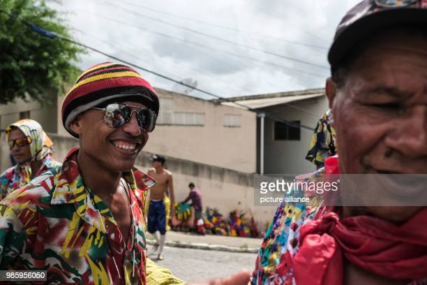 Two men getting ready to take part in a carnival parade in Nazare de Mata Brazil 13 February 2018 Nazare de mata is a small city in northeastern...