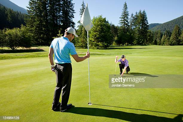 two men golfing. - golf flag stock pictures, royalty-free photos & images