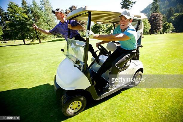 two men gollfing. - golf lustig stock-fotos und bilder
