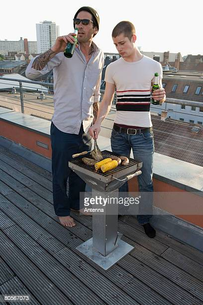 Two Men having a barbeque on a rooftop terrace