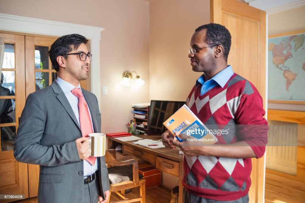 Two men having a business meeting in home office. : Stock Photo