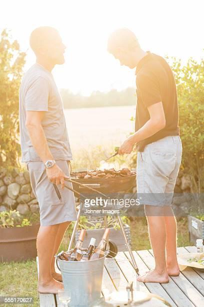 Two men having barbecue