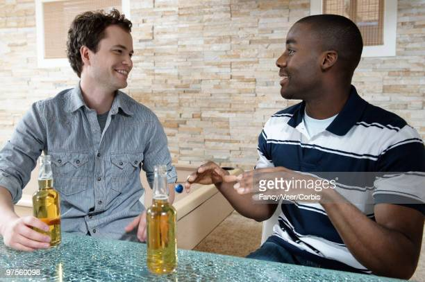 two men having beer - man cave stock pictures, royalty-free photos & images