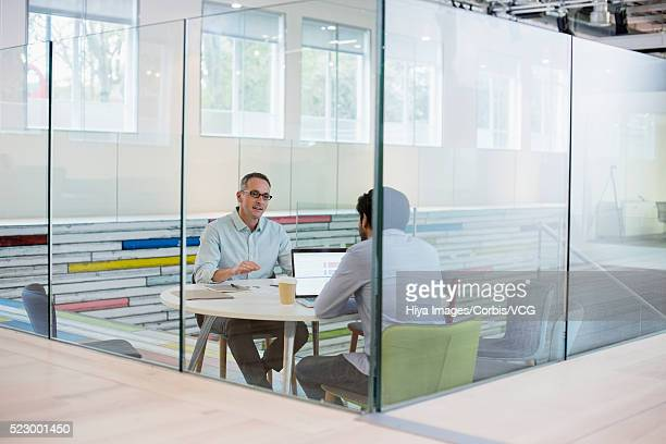 two men having business meeting - vcg stock pictures, royalty-free photos & images