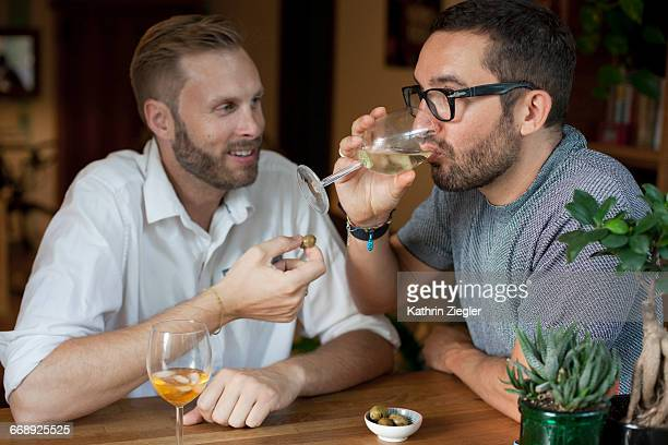 two men having drinks at home