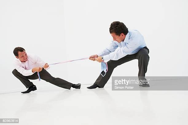 Two men having tug-o-war