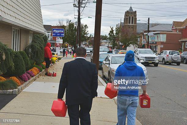 CONTENT] Two men heading towards a local gas station in an attempt to fill up their little red gas tanks Residents lined up for blocks waiting to...