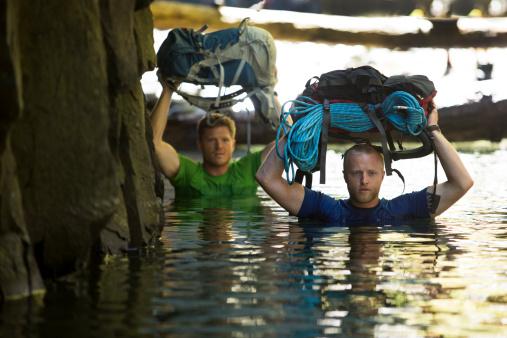 Two men hiking a narrow canyon. - gettyimageskorea