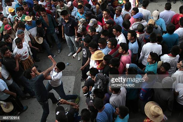 Two men hit each other in a fight representing the Xochimilcas fight to defend their women against the Aztecs in the Mexican municipality of Zitlala...