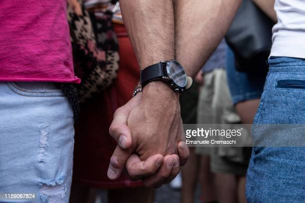 Two men hold each other's hand as they take part in the traditional Gay Pride Parade on behalf of Milano Pride on June 29, 2019 in Milan, Italy....