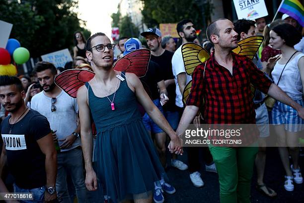Two men hold hands as they take part in the annual Gay Pride parade in Athens on June 13 2015 Greece's radicalleft government on June 10 proposed a...