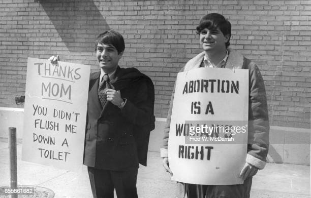 Two men hold signs during a abortion rights march New York New York March 28 1970 The sign at left reads 'Thanks Mom You Didn't Flush Me Down a...