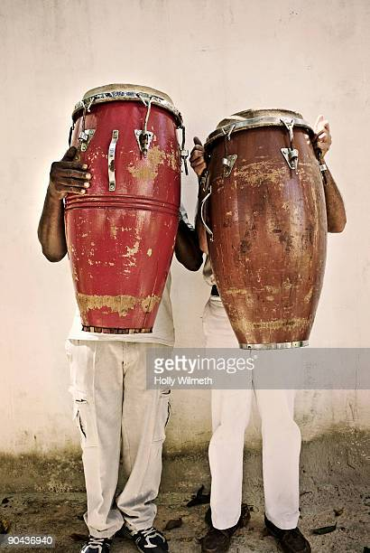 two men holding bongos in front of their faces - drum percussion instrument stock pictures, royalty-free photos & images