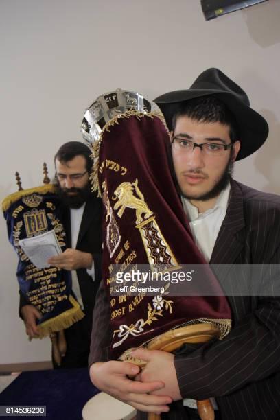 Two men holding scrolls at the new Sefer Torah celebration
