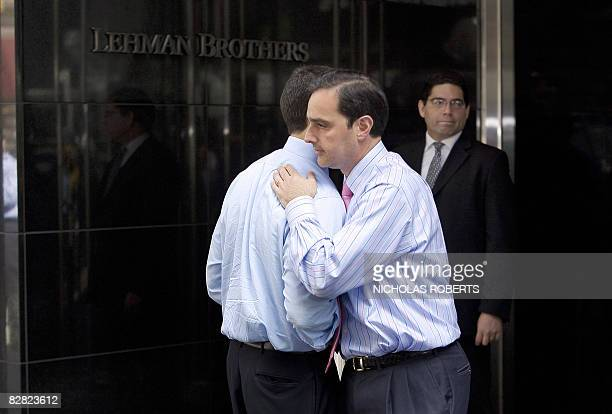 Two men hug outside of Lehman Brothers headquarters in New York on September 15 2008 Treasury Secretary Henry Paulson said Monday that the US banking...