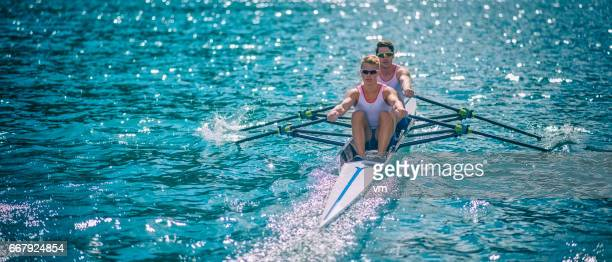 Two men in a rowboat