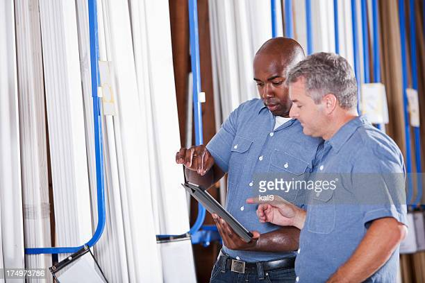 Two men in building supply store