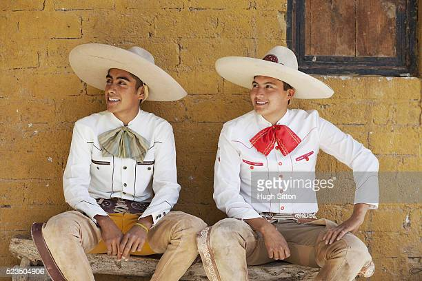 two men in charro costumes - hugh sitton stock-fotos und bilder