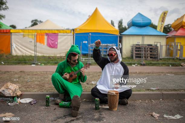 Two men in costumes are playing a small drum and a ukulele at the 2017 Woodstock Festival Poland on August 4 2017 in Kostrzyn Poland The threeday...