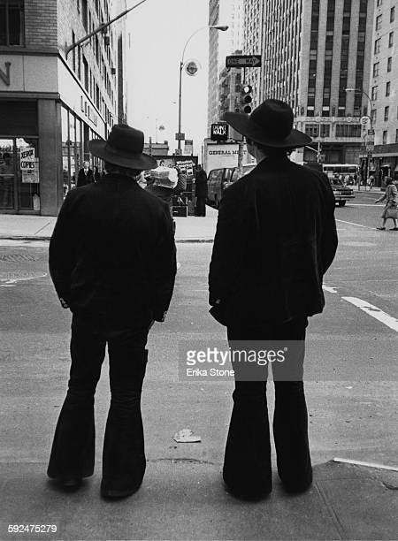 Two men in flared trousers in New York City circa 1975