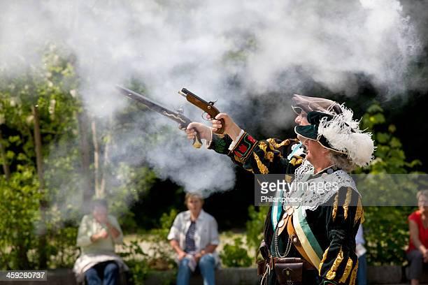 two men in historical costumes with handguns - only men stockfoto's en -beelden
