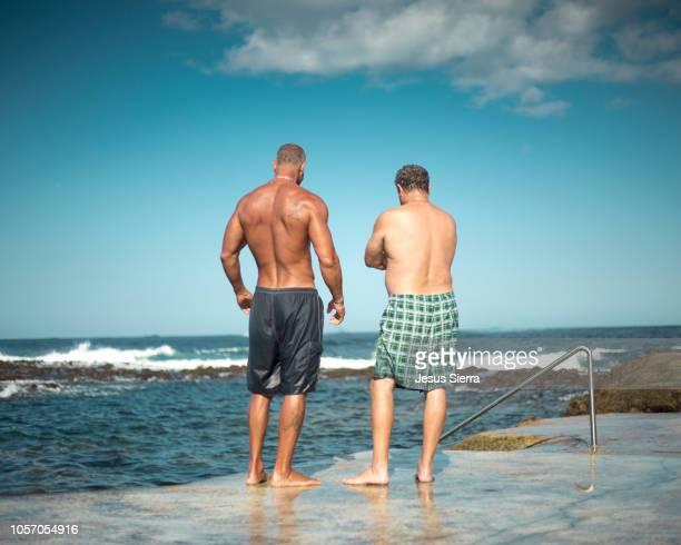 two men in nature pool. vila nova. terceira island. azores. - only men stockfoto's en -beelden