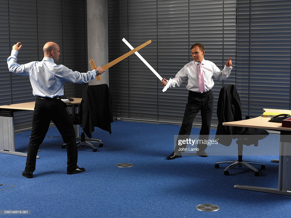 office play. Two Men In Office, Play Sword Fighting Using Large Rulers : Stock Photo Office