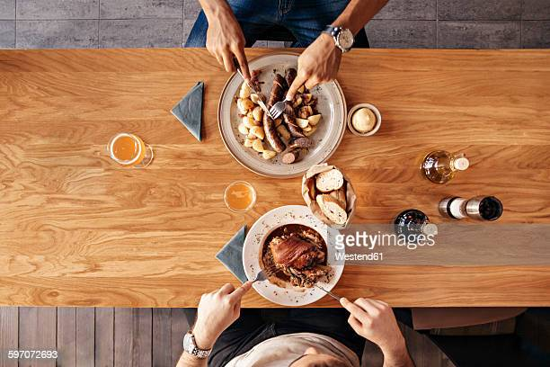 Two men in restaurant having lunch