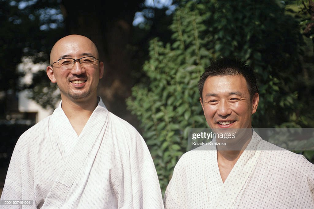 Two men in robes smiling, portrait : ストックフォト