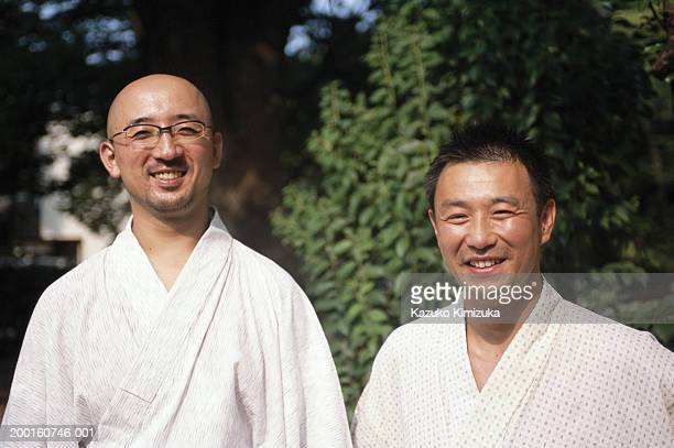 two men in robes smiling, portrait - kazuko kimizuka stock-fotos und bilder