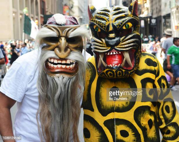 Two men in scary outfits at the Mexican Day Parade in New York City