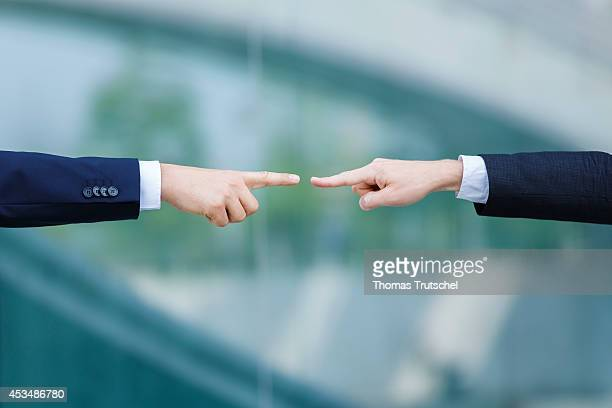 Two men in suits pointing fingers on each other on August 07 2014 in Berlin Germany
